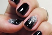 05 shiny black nails with touches of silver glitter look chic and glam