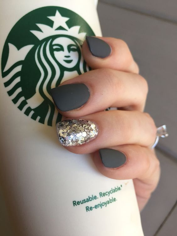 a dark grey manicure with a glitter accent nail will do for any time in the fall and winter