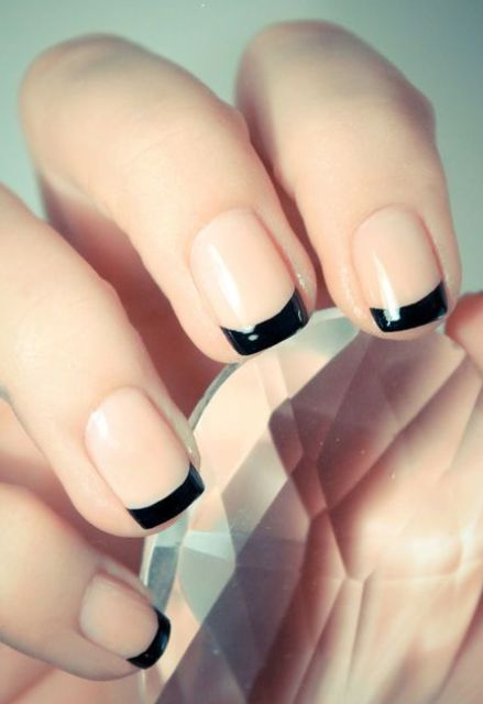 a modern take on French nails is nude nails plus black