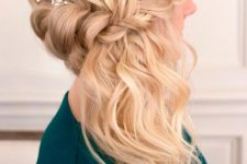 06 a side braided half updo accessorized with a small flower branch