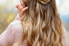 06 a whimsy fishtail braid and rose half updo with wavy hair down