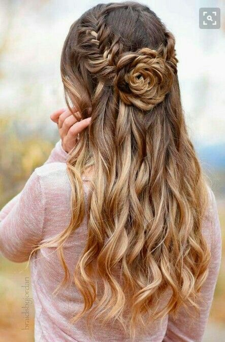Picture Of A Whimsy Fishtail Braid And Rose Half Updo With Wavy Hair Down