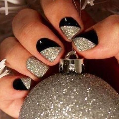 dazzling party manicure in black and silver glitter with a geometric design