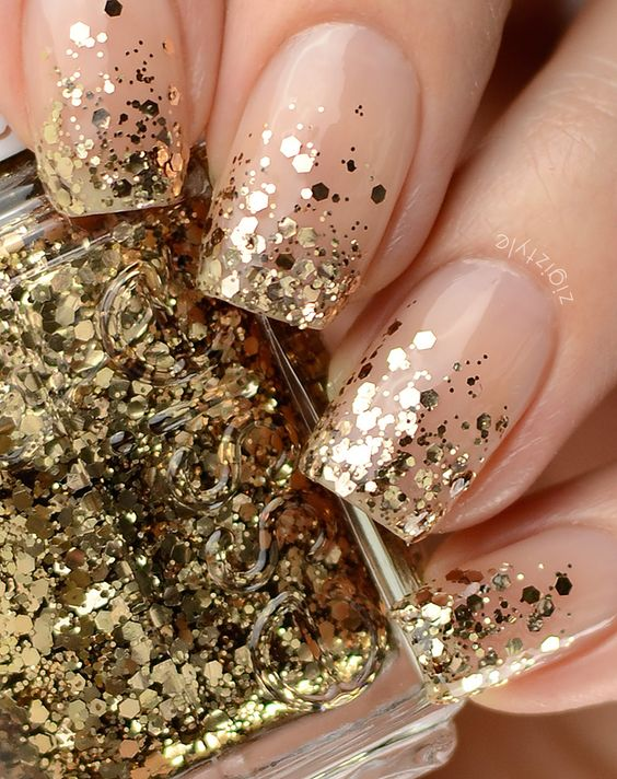 neutral nails with gold glitter hexagons look very chic and feminine