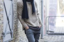 07 a neutral sweater, a navy scarf, grey jeans, brown sneakers for a relaxed feel