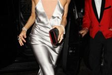 07 a silver slip knee dress with a covered plunging neckline, black shoes and a clutch