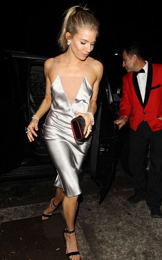 a silver slip knee dress with a covered plunging neckline, black shoes and a clutch