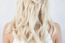 07 a twist half up braid with wavy hair down is easy to make and will take a couple of minutes