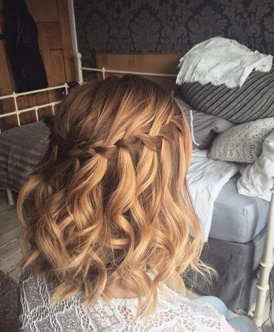 a wavy half updo with a braided top