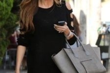 07 black leggings and a cutout shoulder black sweater is a simpel and cool combo