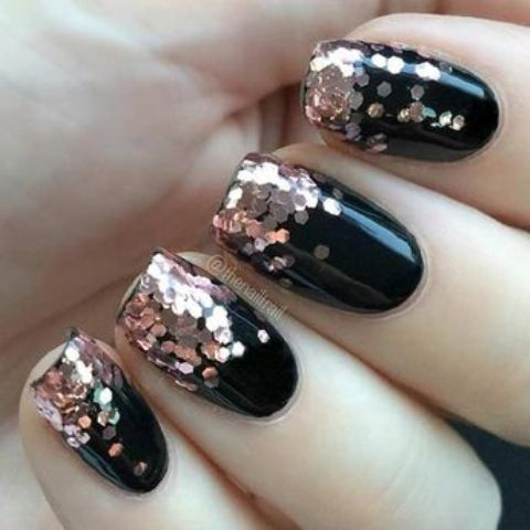 black nails with large copper glitter touches look chic and timeless