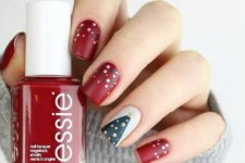 07 matte red nails with polka dots and an accent white nail with a Christmas tree