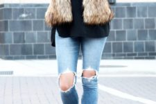 07 ripped jeans, a black sweater, black boots and a faux fur vest
