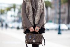08 a brown sweater, a faux fur vest, a black mini and black suede booties