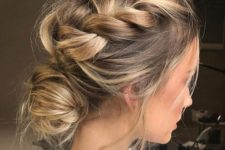 08 a messy braided updo with a low bun looks casual and will do for any party