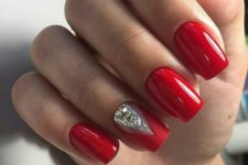 08 a red manicure, an accent matte nail with large rhinestones for a bold look