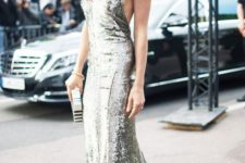 08 a silver sequin floor-length slip dress paired with drop earrings, a box clutch, and a red lip