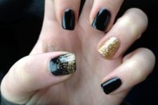 08 black nails with a gold glitter accent nail and a touch of glitter