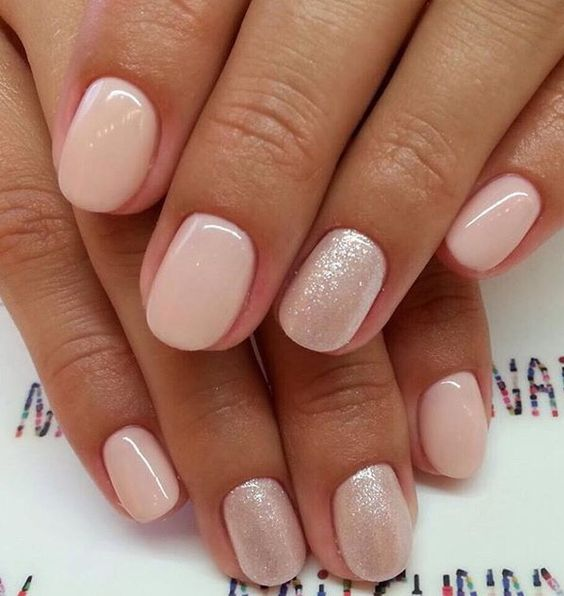 shiny nude nails and several shimmer accent ones for a chic look