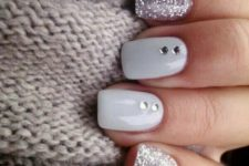 08 silver glitter nails with white ones dotted with rhinestones for a sparkly touch
