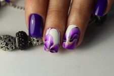 08 violet manicure with bold floral accent ones for a girlish feel