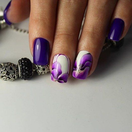 violet manicure with bold floral accent ones for a girlish feel