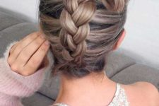 09 a fun braided updo with a large hair bow on top for a whimsy look