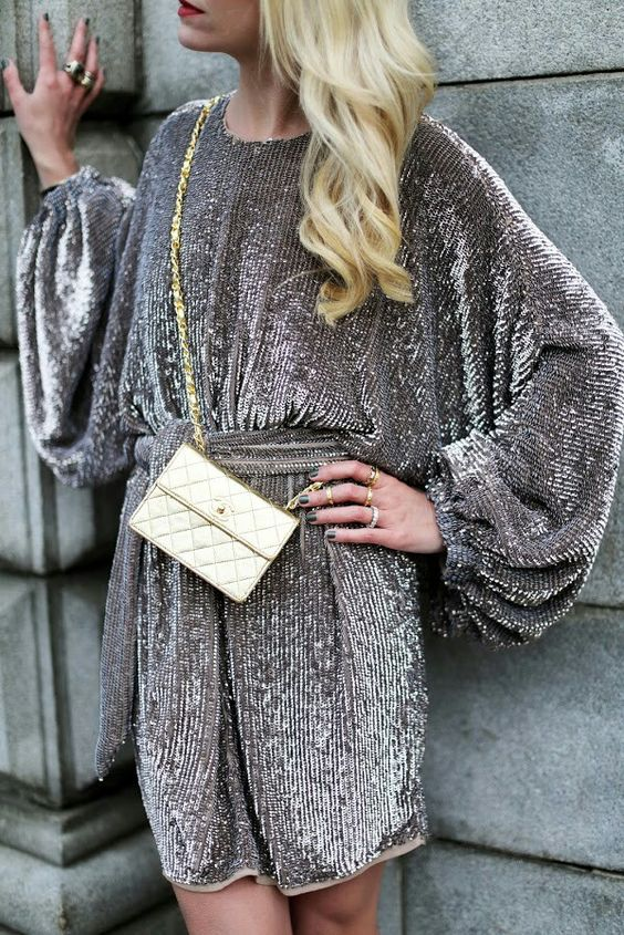 a grey sequin mini dress with wide sleeves and a sash looks stunning and is easy to style