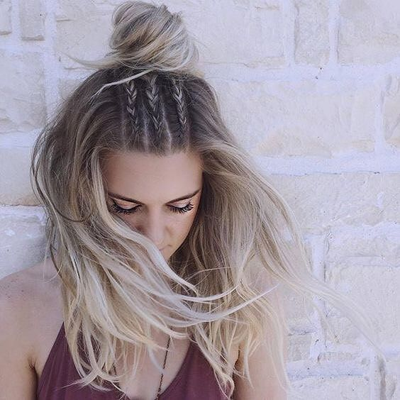 a top knot with three little braids and hair down looks very boho and cool