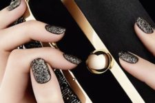 09 black manicure with gold glitter touches all over for a refined look