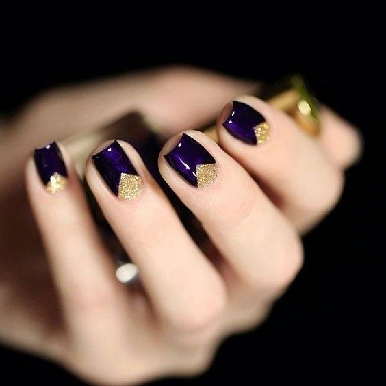 deep purple nails with gold glitter geometric detailing for a fun look