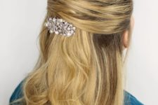 10 a criss cross half updo with wavy hair down on long hair