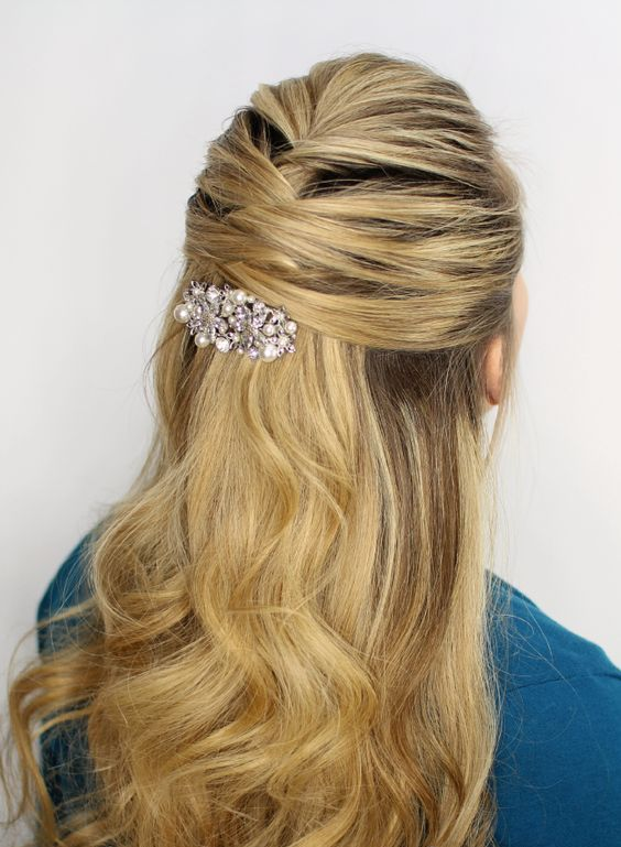 a criss cross half updo with wavy hair down on long hair