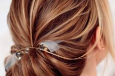 10 a messy chignon hairstyle with a ribbon and bead hairpiece