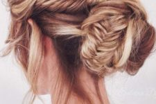 10 a messy fishtail braid with a low bun and bangs down