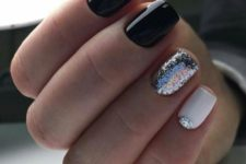 10 black and white nails with a silver glitter nail and a silver half moon touch