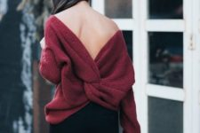 10 black jeans, a maroon cutout back sweater with a knot