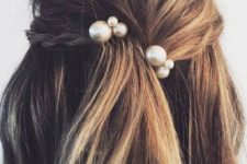 10 messy hair with a small braid and large pearl pins as accessories