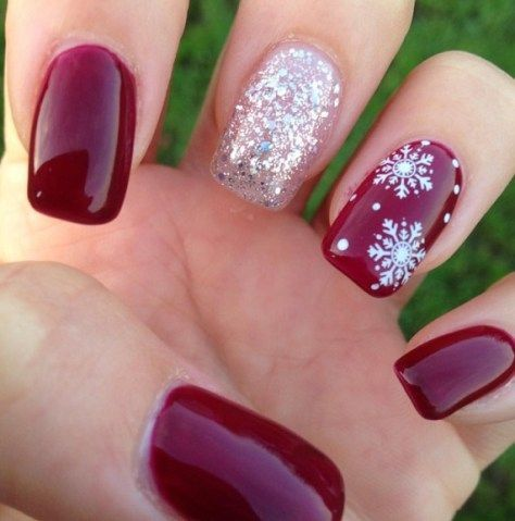 red nails with a silver glitter one and a snowflake one look cute and very wintery