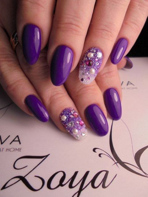 ultra-violet manicure with bold accent nails with rhinestones, pearls and sequins