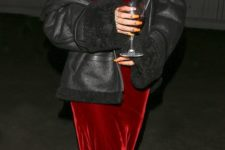 11 a burgundy velvet slip dress, metallic shoes and a black shearling coat by Rihanna