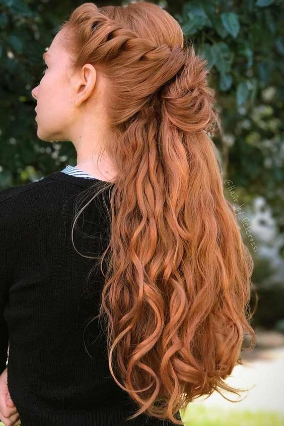 a half updo with a braided top and waves is a timeless romantic hairstyle