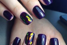 11 deep violet nails with holographic accents for those who love geometry