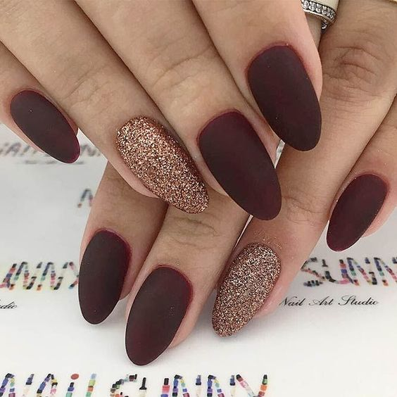 matte burgundy nails with copper glitter accent nails for Christmas
