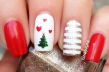 11 red manicure with a striped nail and a Christmas tree nail with hearts for a cute look