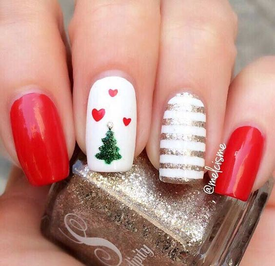 red manicure with a striped nail and a Christmas tree nail with hearts for a cute look