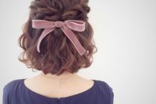 11 wavy short hair with a twisted braid and a pink velvet bow