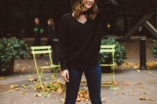 12 a black chunky kit sweater, navy jeans and black suede boots