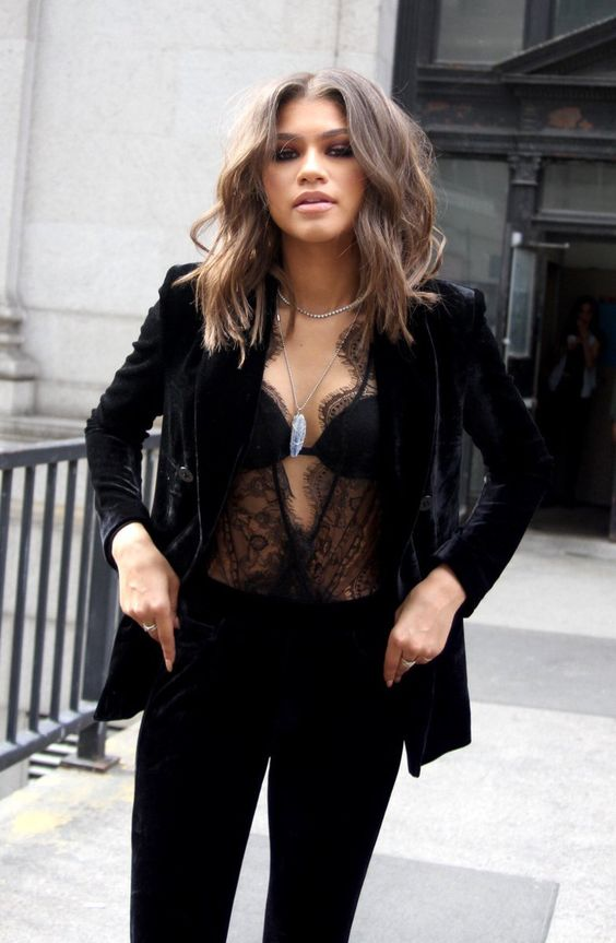 a black velvet suit and a sheer lace top underneath for daring girls