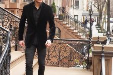 12 black jeans, a black shirt, a black velvet blazer and black boots, velvet is the trend of this year